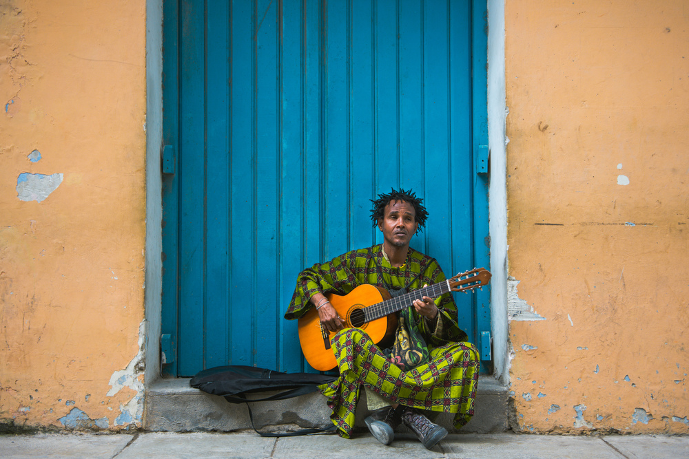 ISO 200 / 30mm/ f2.8 / 1/400sec -  Many Cubans make a living on the streets of Old Havana playing music to tourists.