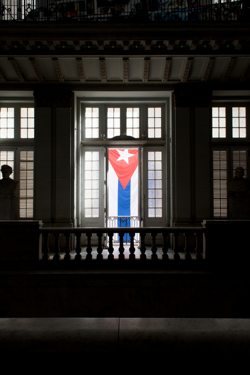 ISO 200 / 17mm / f7.1 / 1/100sec -   Cuban flag hanging in the Museum of the Revolution. The building used to be the Presidential Palanace before it was stormed by the Fidel and his guys.