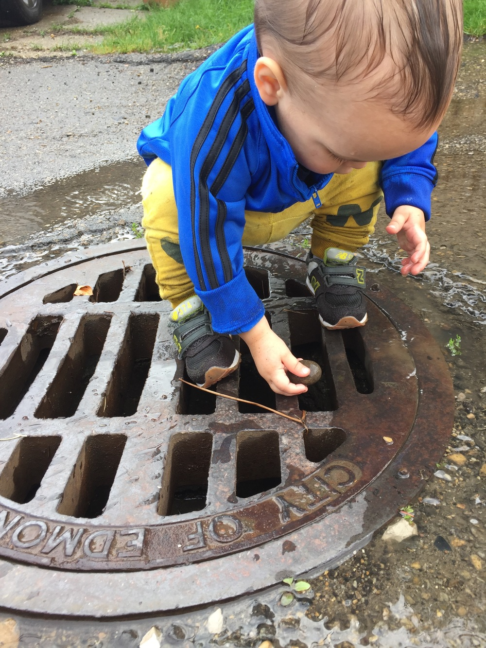My child playing in a gutter; because, why not?