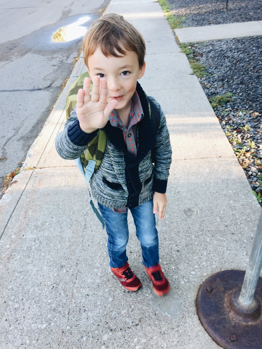 "My son saying ""No pics mom!"" as I try and take an Instagram-worthy shot of him getting on the bus for the first time."