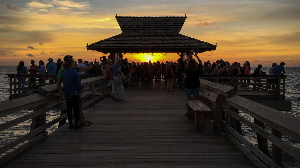 Tourists and locals gather to watch the sunset from Naples Fishing Pier. ©Adrian McGarry 2016