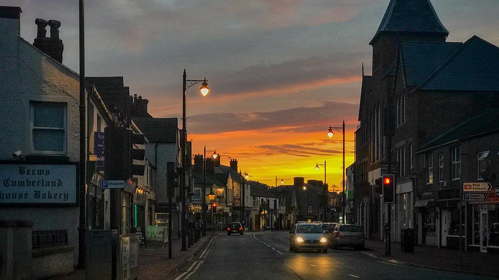 Abergele main street at sunset.