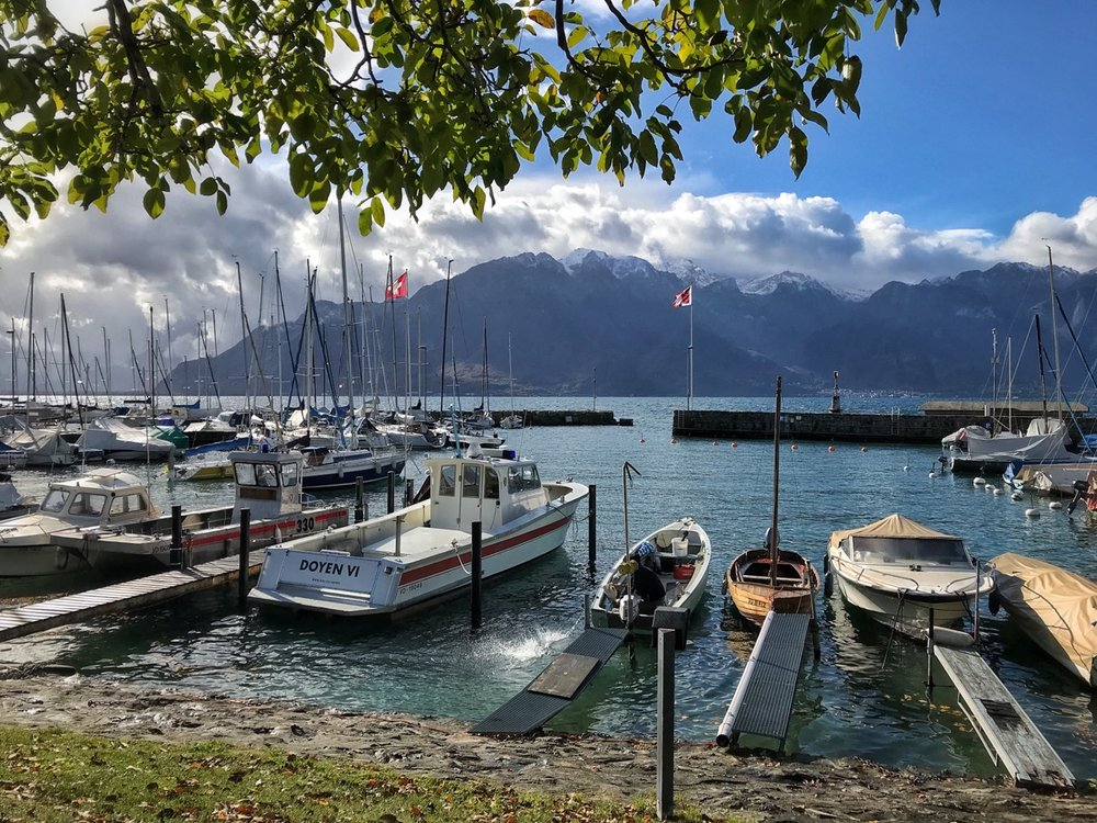 Snow capped mountains line the shores of Lake Geneva at La Tour-de-Peliz near Lausanne.