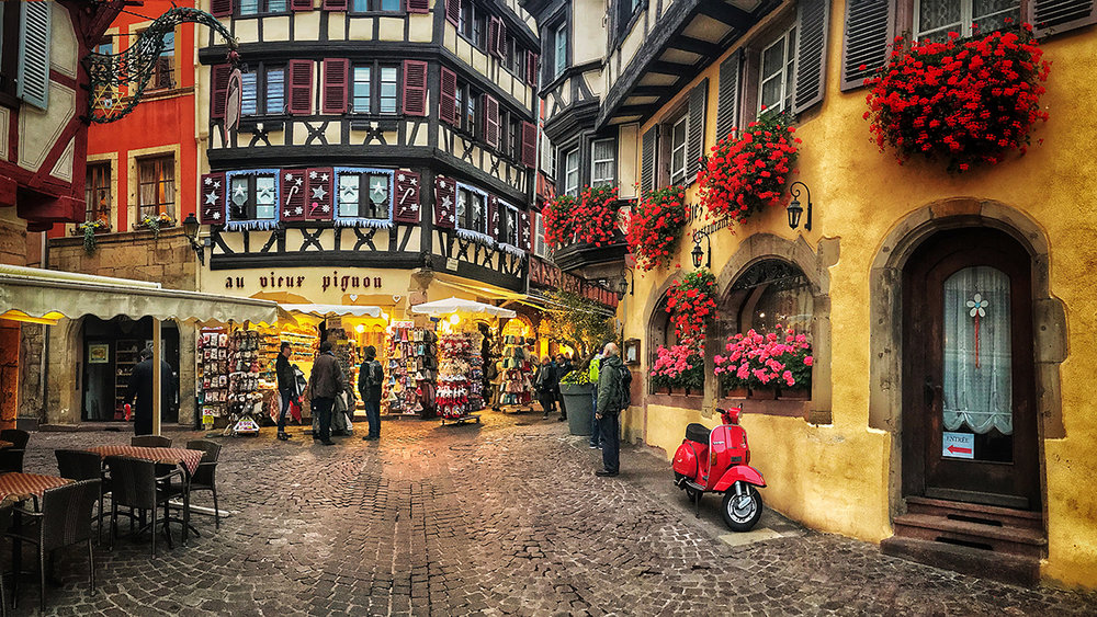 Colmar, half-timbered buildings in paint-box colours line cobblestone streets to the delight of tourists.