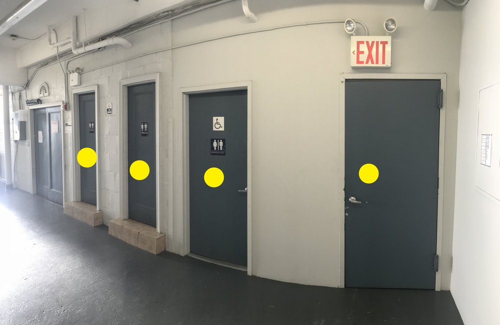 There are three restrooms, one wheelchair assessable, and a garbage room directly outside the gallery