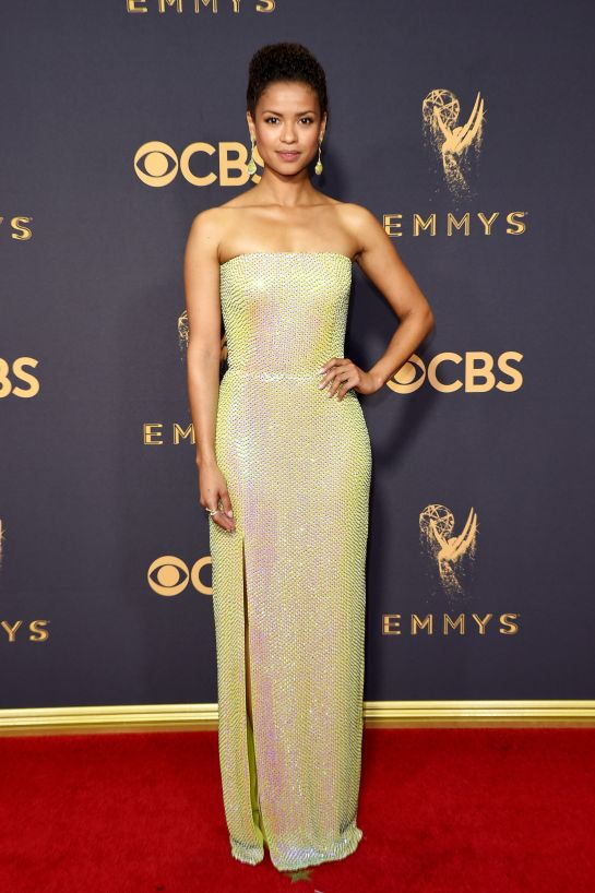 Gugu Mbatha-Raw - These colors looked so beautiful on her with this natural beat and up-do.