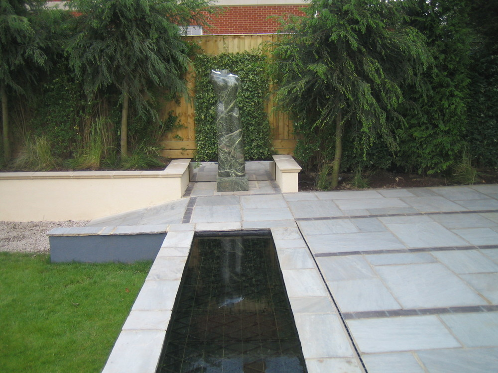 Patio with Water Feature and Landscaped Lawn