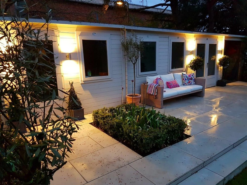 Patio at Night Image with Landscaped Hedge