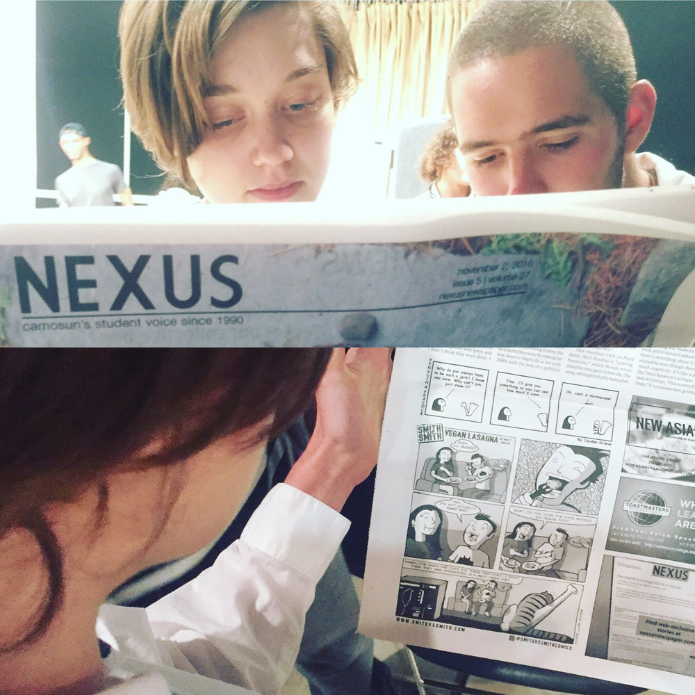Two comics & graphic novels students enjoying smith vs smith in the nexus newspaper.