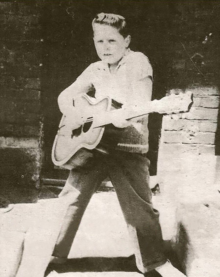 Mark with his first guitar
