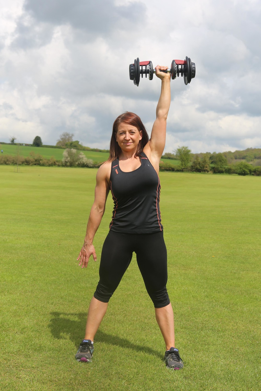 Kettlebell press to strengthen the shoulders and shape the arms