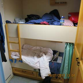 Our cozy cabin equipped with bunk beds and closets