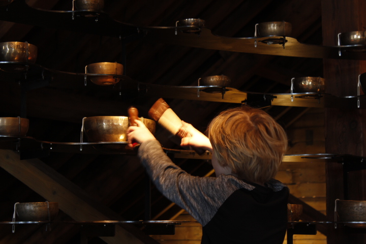 A young visitor creates sounds with the Tibetan Prayer Bowls that make up the Artangel Installation, Longplayer.