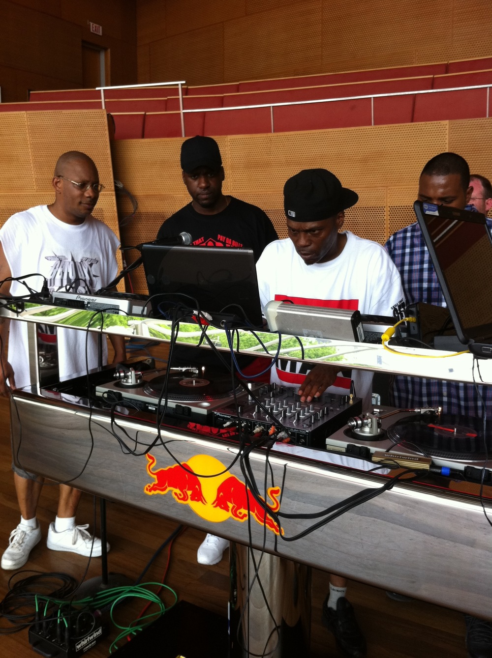 Event Producer and Co-Curator for Audio Picnic music series at the Jay Prizker Pavilion in Millennium Park. Red Bull session with DJ Rashad and Traxman in photo.
