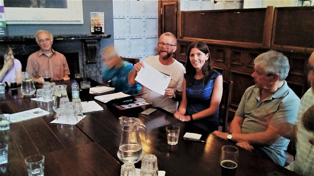 Tim presenting the petition to Michelle Donelan at MVM Chippenham's public meeting.