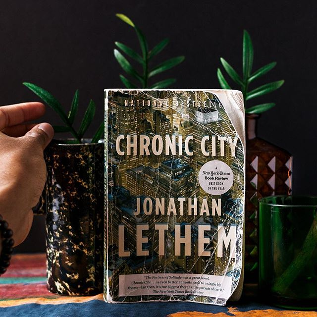 In Chronic City, Jonathan Lethem presents a New York City filled with inexplicably long winters, excavating tigers, and pop culture conspiracy theories. Caught in the middle is Chase Insteadman, a perpetual everyman looking for purpose after child stardom. He finds that purpose—or at least some semblance of it—in Perkus Tooth, an awkward, rambling, intellectual pothead who enraptures Chase with theories on entertainment minutiae that, according to Perkus, explain vital inner workings of the world. Mild adventures ensue that possibly give credence to Perkus' claim. Unfortunately, like his main character, Lethem's novel seems forever stuck in a middle of something, trying to weasel its way out of those adventures but never succeeding or offering a resolution for the reader. The end result is a neurotic sludge of a book caught between the fantastical and the practical, with the potential to soar into brilliance but hellbent on obsessively clipping its wings. Read more of my thoughts on my website through the link in bio. ⠀ ---⠀ #bookstagram #booklover #bookworm #instabookers #reader #bookaholic #bookphotography #bookaddict #booksofinstagram #bookish #bookreview #jonathanlethem #chroniccity #bookreviews #bookreviewer #booknerds #booksofinsta #bibliophile # #igreads #reading #booknerdigans #bookporn #bookphoto #ilovebooks #instareads #introvertlife #read #blackbloggers #blkcreatives #blackwhoblogs