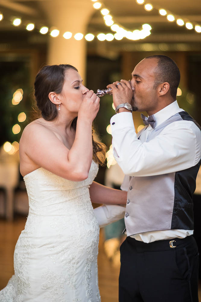 A bride and groom toasting during their wedding at Windows on Washington.