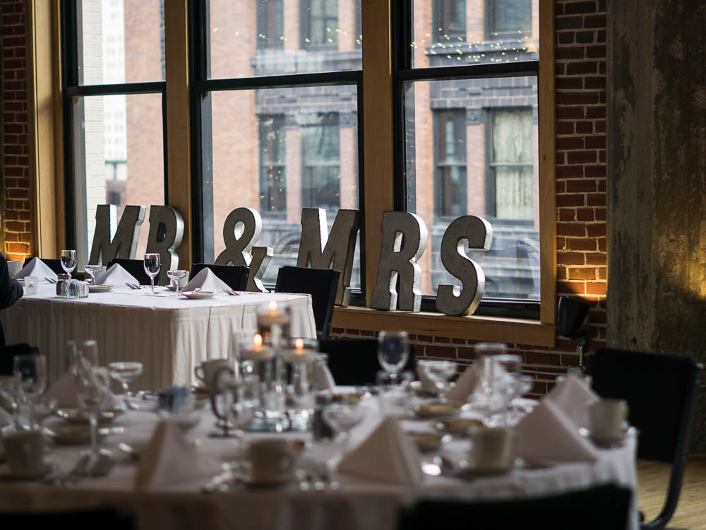 Mr. and Mrs. signs at a wedding table at Windows on Washington for a summer wedding.