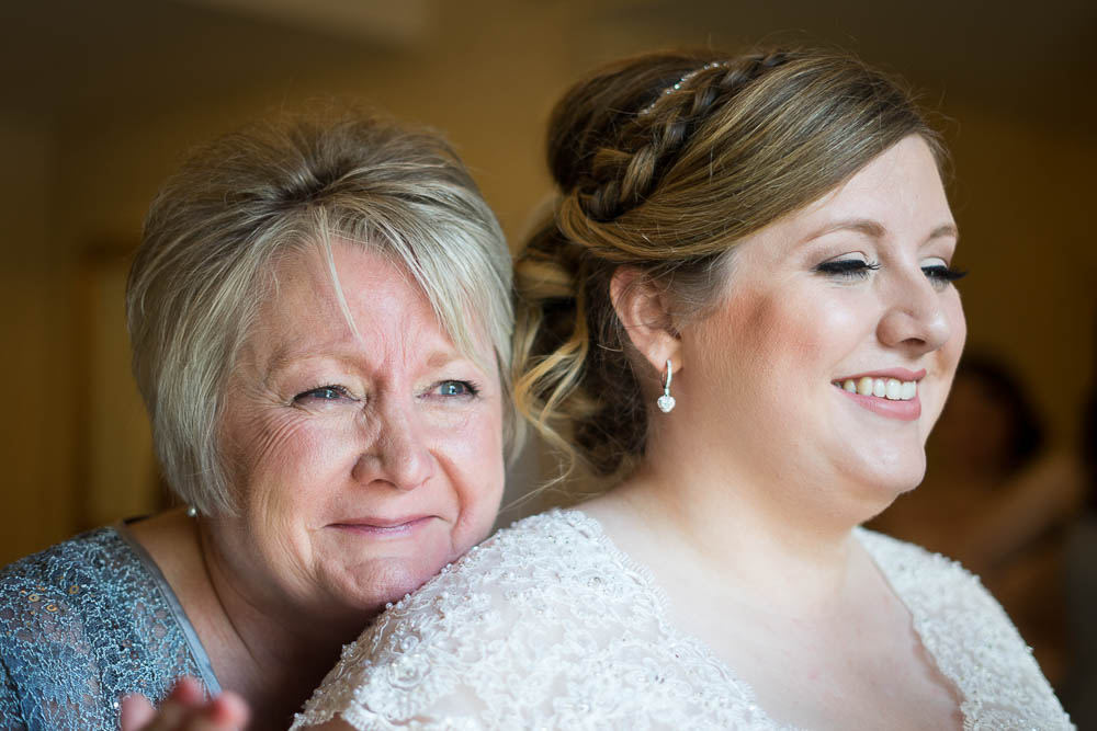 A portrait of a bride and her crying mother.