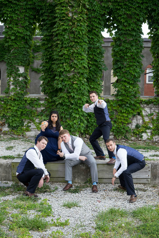 Portrait of groomsmen posing for a silly photograph.