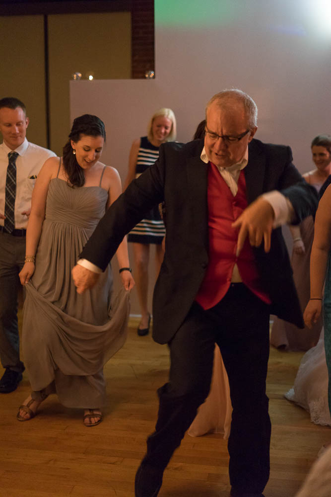 A wedding guest busts a move while dancing at a wedding reception at Jim Edmonds Space 15.