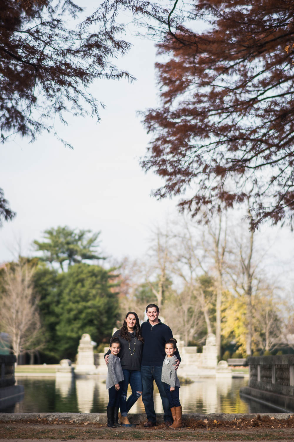 A portrait of a family at Tower Grove Park.