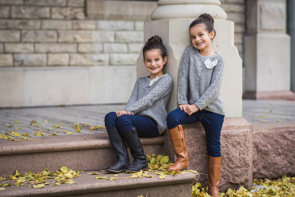 Children pose during a family photoshoot in Tower Grove Park.