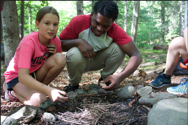 Dreamer Andrew Robinson working with a camper during his position as a Counselor in Training (CIT) at Frost Valley YMCA.