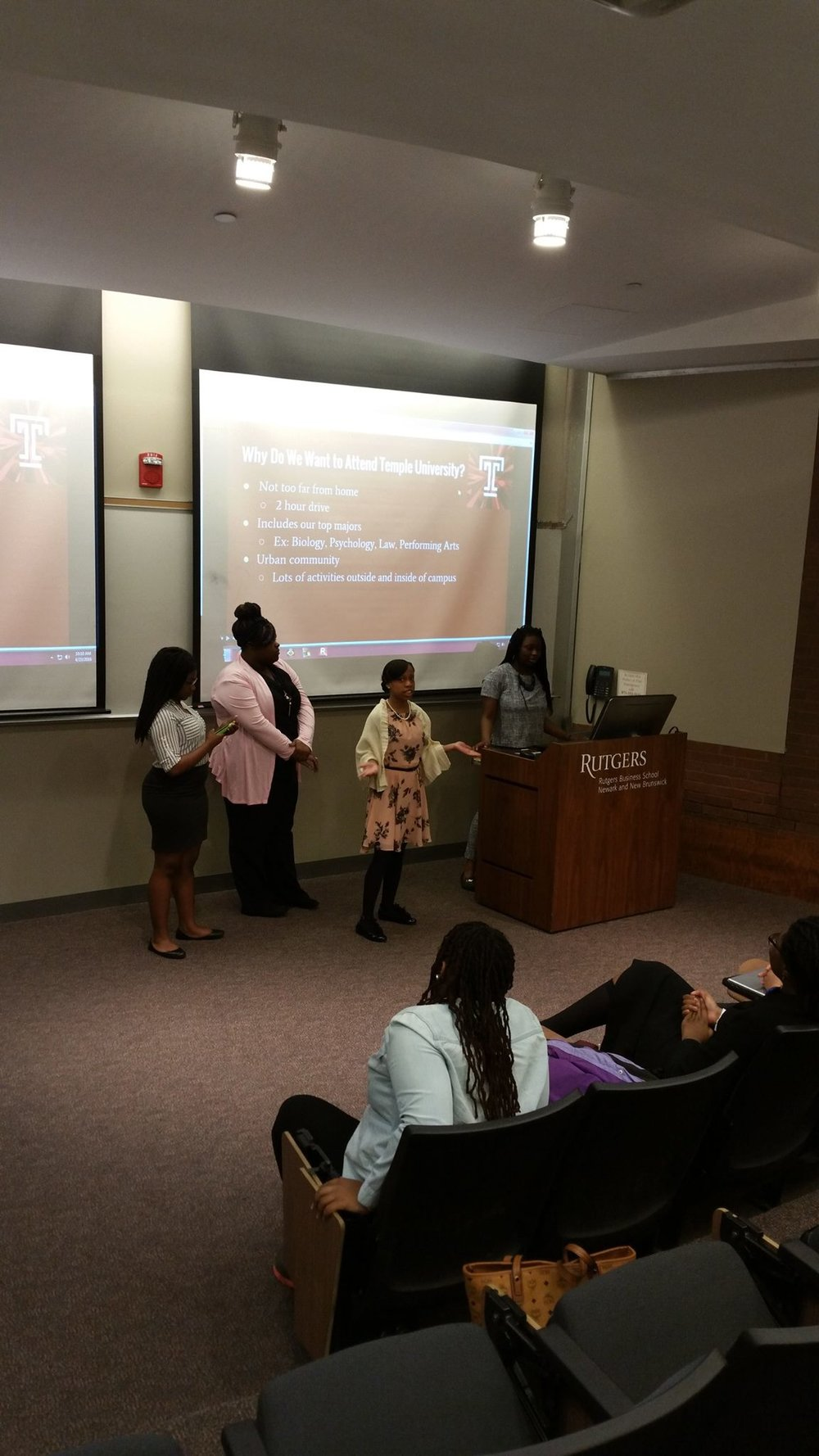 Dreamers giving their college research presentations at Rutgers University with the Young Women in Business.
