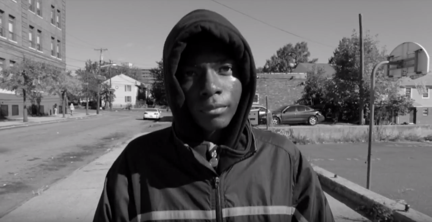 A photo from Mentored's video of Dreamer Tianjin Washington's journey to his local library.