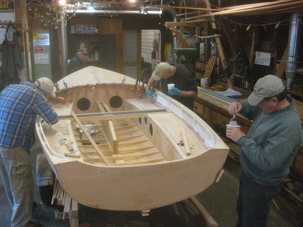 Rick, Mike, and Larry are painting the areas of the GANNET which will be difficult to reach once the side decks are installed.