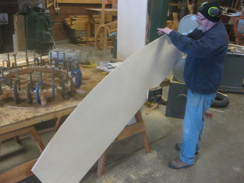 Nigel shapes a component of the LILLIPUT pram mold. The pram will be planked over the mold, which defines the shape of the boat.