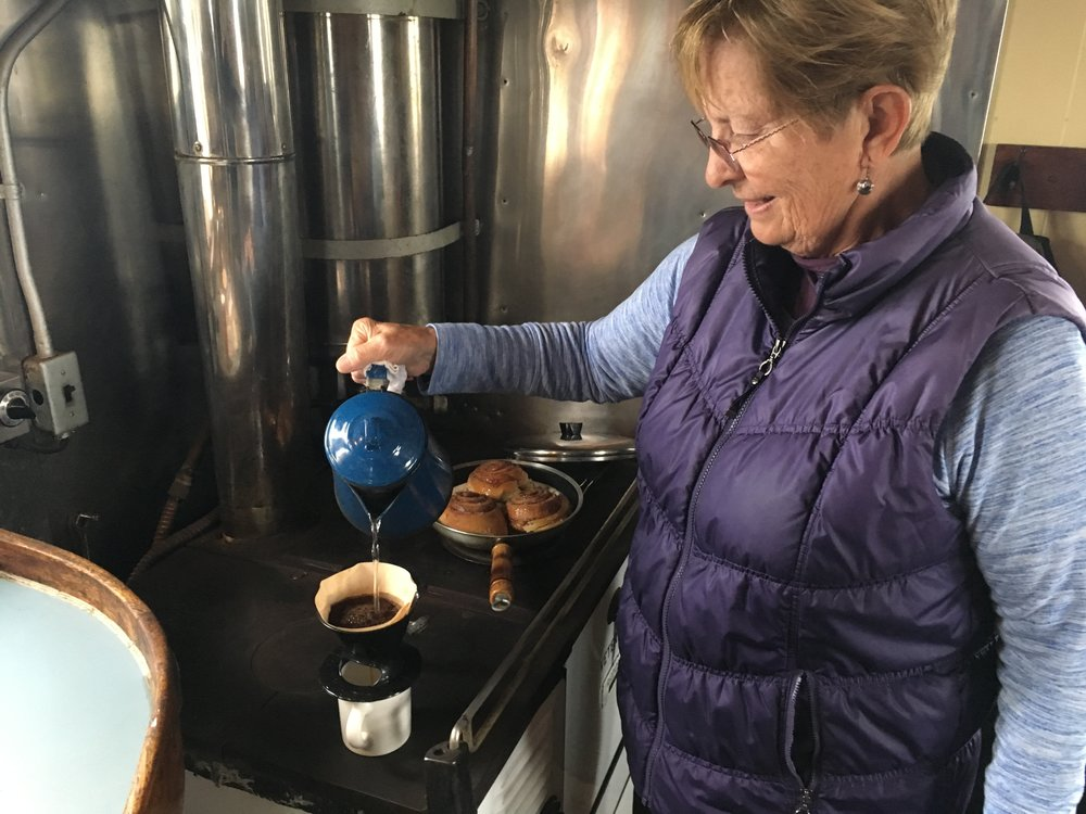 Patt Lapp prepares coffee and treats in the galley during an excursion.