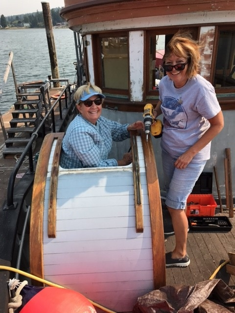 Patt Lapp and Dawn Ellis at work on the scuttle.