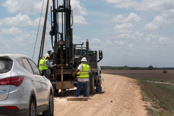 Workers take soil samples on the levee at the Santa Ana National Wildlife Refuge.  Photo thanks to Texas Observer.