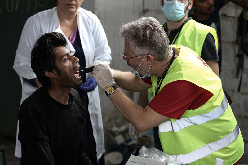 From NPR article:  A migrant receives medical attention at a former paper factory in Greece that has been turned into a makeshift camp.   Menelaos Michalatos/SOPA Images/LightRocket via Getty Images