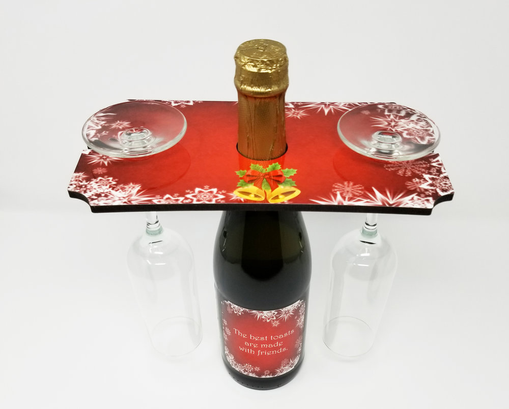 "SQUARE CADDIE . Hardboard tray with hole for the wine bottle and slots for the glasses.  White Gloss, 1-sided. 5.25""x 9.5"" x.25"". Clever little tray enables a  great presentation for restaurants or attractive side board displays. A  great gift item.  $15.00"