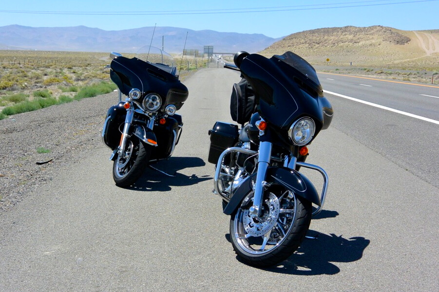 Gerber and Clooney's bikes on the side of the road during a pitstop.