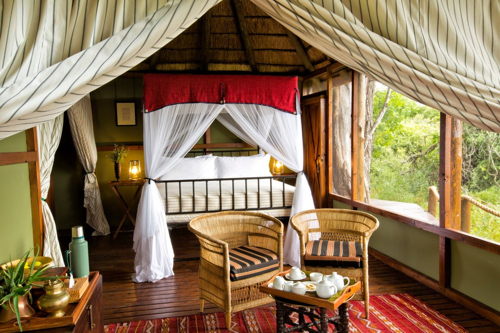 3Mapula Lodge - Double bed and seating area.jpg