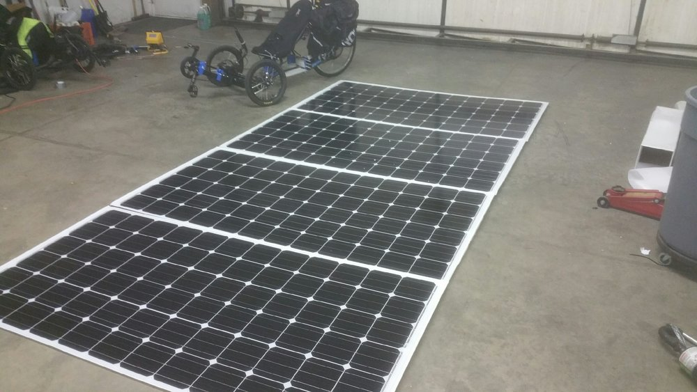 Four 300w 36v solar panels, one Mk. 5 Experimental for scale