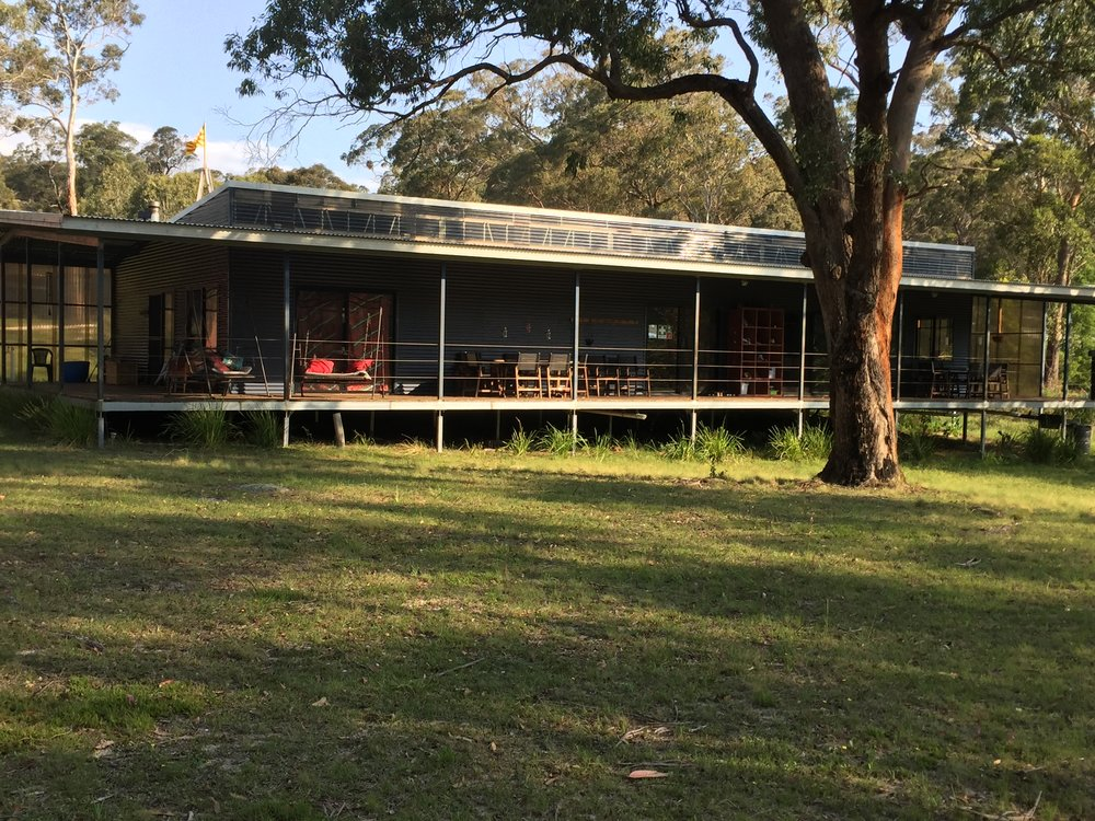 'The Ark' : the meditation and music space , with adjacent dining and open kitchen, and old fashioned verandah looking into the forest and creek.