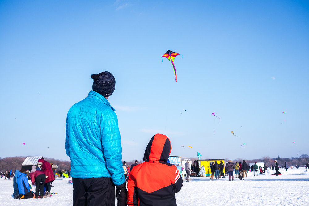Father and son with their kite at Lake Harriet Winter Kite Festival, Minneapolis, Minnesota