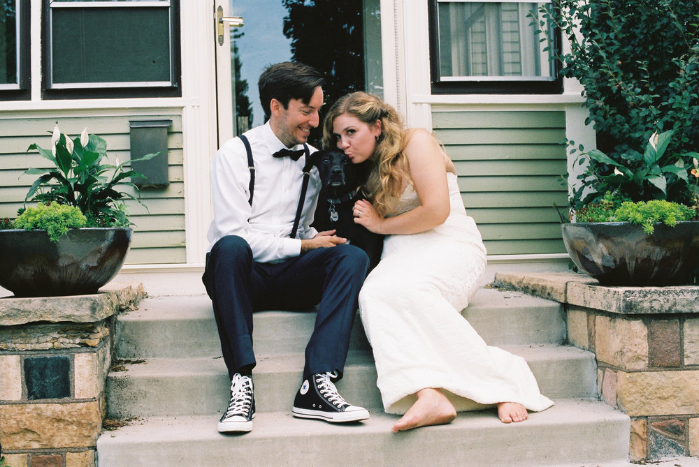 Eric and Kelsey and Porter on their front stoop