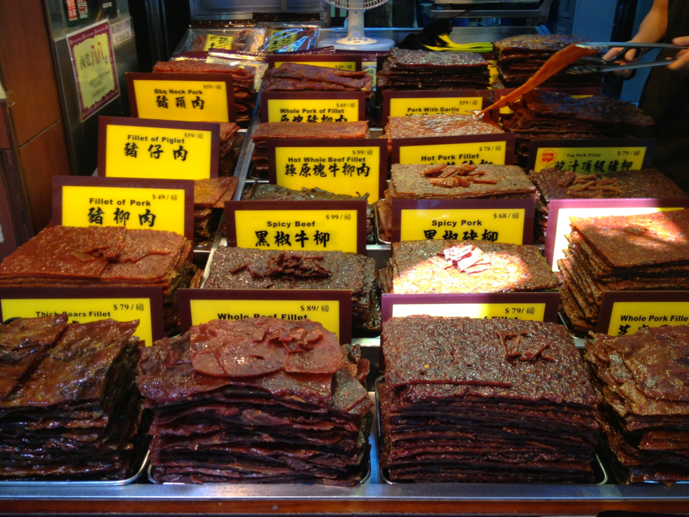 Varieties of bak kwa for sale at a street side vendor