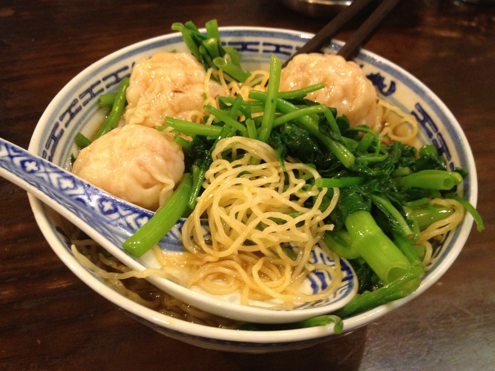 Prawn won ton soup with yellow noodles and vegetables