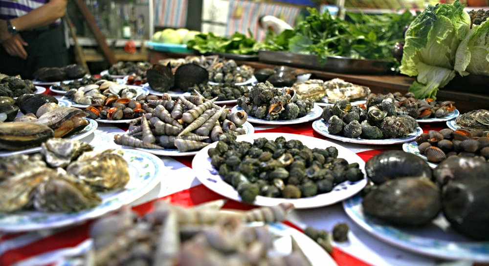 Assorted shellfish and mollusks on display for diners to select