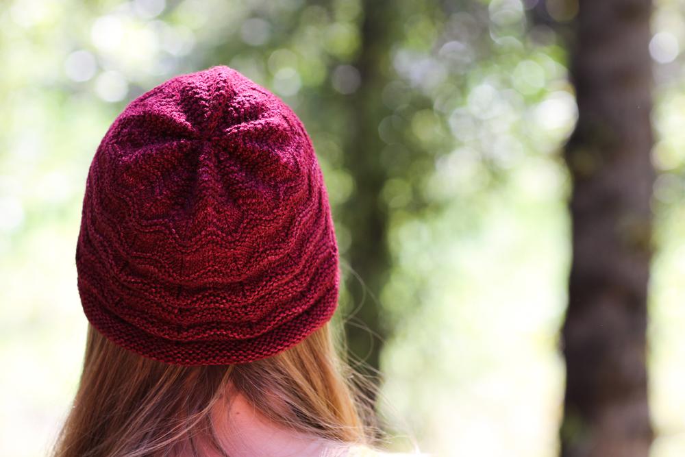 "Hat: ""Norby"" by Gudrun Johnston. Yarn:Malabrigo Yarn Sock in ""Tiziano Red."""