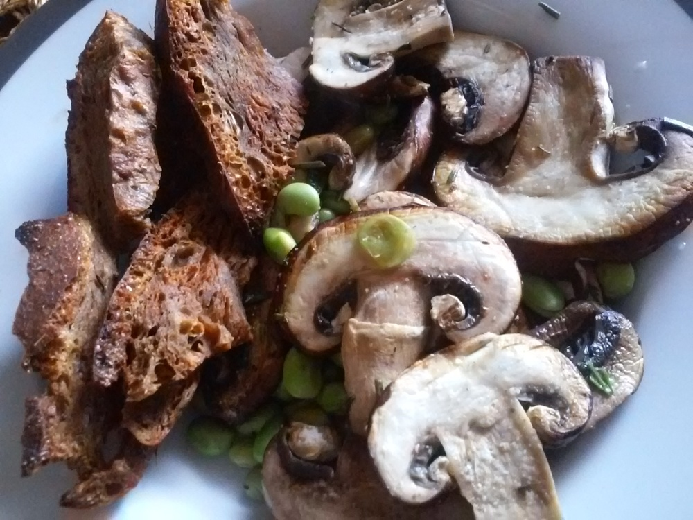 Seitan with a side of sauteed mushrooms and herbs