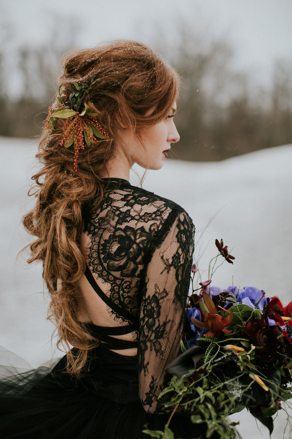 Flying Fox's Llyr and Serpens Rings  in Moonstone and Sterling, shot by  Sarah Brookhart  Photography, model is  Danielle Lehman , bodysuit and skirt by  Sweet Caroline Styles , makeup and hair by  The Bonafide Ginger , florals by  Splints and Daisies .