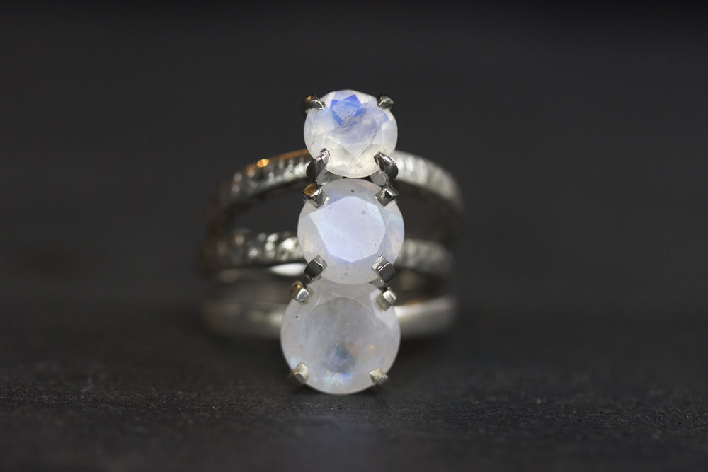 Top to Bottom:  7mm Atlantides Moonstone in 14k White Gold, 8mm Artemis Moonstone in Hammered 14k White Gold, and the 9mm Perigee Moonstone in Sterling Silver, 1.25 ct, 2 ct, and 3 ct respectively. Each stone has it's own character, and no two are exactly the same.
